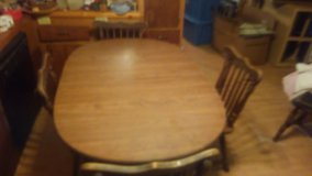 A table and 4 chairs in Camp Lejeune, North Carolina