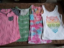 Four women's shirts size M and L. in Camp Pendleton, California