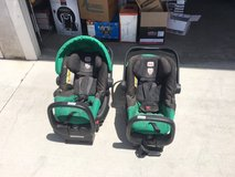 Britax twin stroller and two car seats with bases in San Bernardino, California