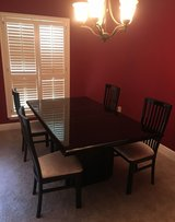 Black lacquer dining room table and 4 chairs in Kingwood, Texas