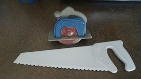 Fred hand saw pizza and cake cutter in St. Charles, Illinois