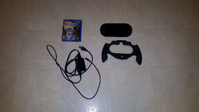 PS Vita with Uncharted, handgrip, & adapter in DeKalb, Illinois