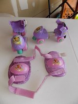 Kids adjustable roller skates with knee pads in Watertown, New York