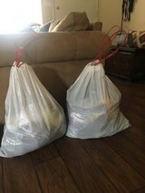 Two bags full of great clothing message for pictures of some of the items in Camp Pendleton, California