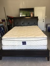 Queen size bed with matress and nightstand in Camp Lejeune, North Carolina