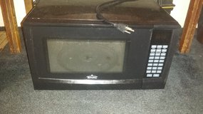 Small black microwave in Hinesville, Georgia