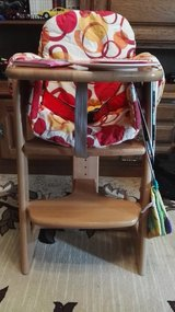 HERLAG wooden high chair with cover and toys in Ramstein, Germany
