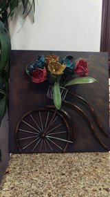 Bicycle wheel with flower basket in Lake Elsinore, California