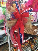 Red white and blue mesh garden flag pole bow in Fort Bragg, North Carolina