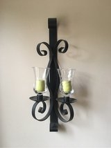 Iron wall sconce with glass globes in Fort Campbell, Kentucky