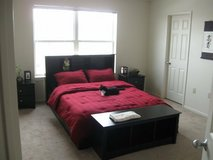 Queen size bed frame with head board and bench in Clarksville, Tennessee