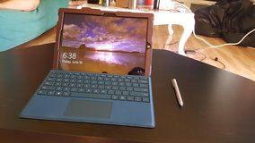 Surface Pro 3 with Purple Keyboard, Brown Leather Case, mini SD card, and Surface Pen in Travis AFB, California