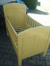 Old German childrens bed in wood in Baumholder, GE