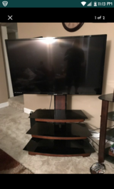 Vizio tv and Swivel Stand in Fort Campbell, Kentucky