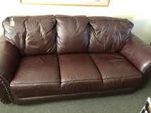 Brown leather couch in Luke AFB, Arizona