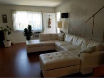 white sectional couch with ottoman in Lake Elsinore, California