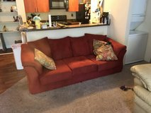 Red couch in Oceanside, California