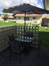 Patio table, chairs, and umbrella in Okinawa, Japan
