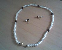 Pearl/Amthyst/Gold necklace and earring set in Palatine, Illinois