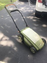 Neuton electric lawn mower and batteries in Glendale Heights, Illinois