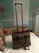 Rolling briefcase-Reba line from Dillard's in Fort Campbell, Kentucky