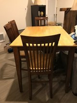 Two tone hightop table with four chairs in Tacoma, Washington