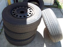 (4) rims and tires for 2004 saturn vue in Naperville, Illinois