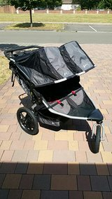 BOB double jogger with cup holder attachment in Ramstein, Germany