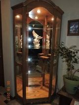 Oak wood curio with light and glass shelves, huge in Fort Riley, Kansas