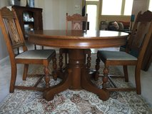 Antique pedestal dining table and chairs in Batavia, Illinois