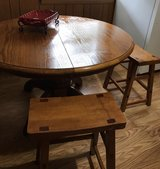 heavy wooden table with 2 stools and a extra leaf in Springfield, Missouri