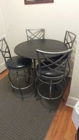 Metal pub table and 4 chairs in Lawton, Oklahoma