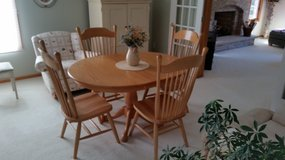 Dining table with 4 chairs. Amish made. Solid light oak. Excellent condition in Morris, Illinois