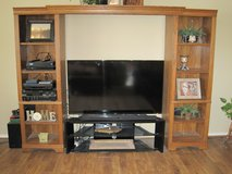 Entertainment center includes TV stand in Kingwood, Texas