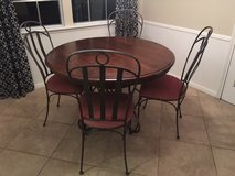 Wooden Kitchen table with rod iron base and chairs in Kingwood, Texas