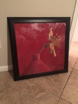 Modern and Simple Yellow flower, red vase picture with black frame in Kingwood, Texas