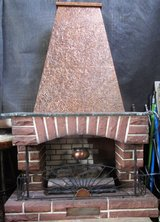 Fireplace with Glowing Logs and Real Heater and Copper Chimney in Ramstein, Germany