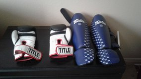Boxing gloves and shin pads in Vista, California