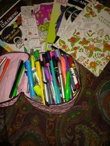 bunch of pens and coloring books in Perry, Georgia