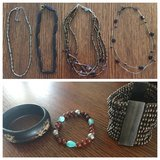 Four brown & silver necklaces and three bracelets in Perry, Georgia