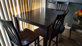 High top cherry table with 4 chairs in Fort Campbell, Kentucky