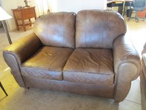 LOVESEAT, BROWN LEATHER FLEXSTEEL,  PURCHASED AT IKARD'S in Las Cruces, New Mexico