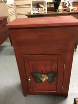 "Small cabinet top opens for storage door on front. 11""wide 21"" long 33"" tall in Conroe, Texas"