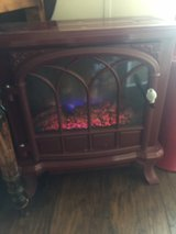 duraflame electric fireplace with remote in Fort Bragg, North Carolina