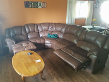 Brown leather Sectional reclining sofa in Bartlett, Illinois
