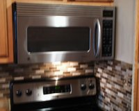 GE  1.6 cu. ft. Over the Range Microwave Oven in Stainless Steel in Fort Campbell, Kentucky