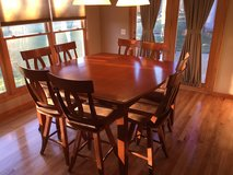 Dining Set - Counter Height Table/8 Swivel Chairs in Jacksonville, Florida