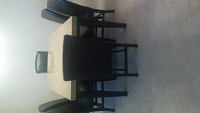 Dining Room Table with Six Brown Leather Chairs in Lake Elsinore, California