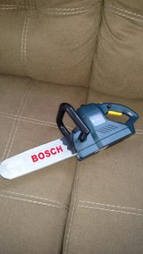 Battery operated chainsaw toy in great condition in Beaufort, South Carolina