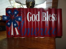 """God Bless America"" tin wall hanging in Chicago, Illinois"